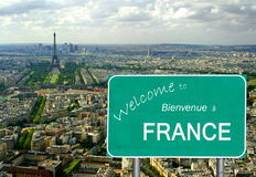 Welcome to France sign with Eiffel Tower Stock Images