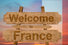 Welcome to France sing on wood background with blending national flag Royalty Free Stock Photography