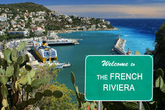 Welcome to the French Riviera sign. Showing harbor of Nice, France in the background  ( focus on the sign Royalty Free Stock Image