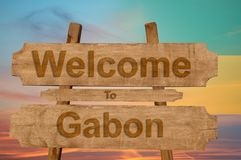 Welcome to Gabon sing on wood background with blending national flag Royalty Free Stock Images
