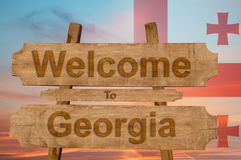Welcome to Georgia sing on wood background with blending national flag Royalty Free Stock Photo