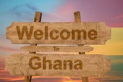 Welcome to Ghana sing on wood background with blending national flag Stock Photo