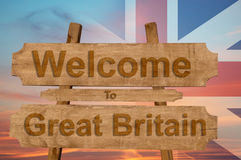 Welcome to Great Britain sing on wood background with blending national flag Royalty Free Stock Photo