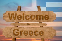 Welcome to Greece sing on wood background with blending national flag Royalty Free Stock Images