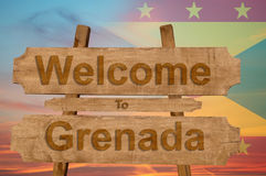 Welcome to Grenada sing on wood background with blending national flag Royalty Free Stock Image
