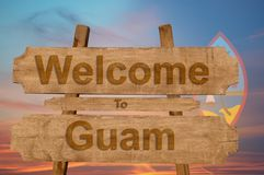 Welcome to Guam sing on wood background with blending national flag Royalty Free Stock Photo
