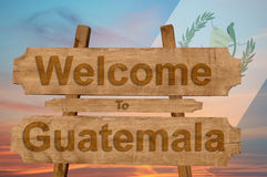 Welcome to Guatemala sing on wood background with blending national flag Royalty Free Stock Images