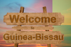 Welcome to Guinea Bissau sing on wood background with blending national flag Royalty Free Stock Images