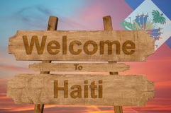 Welcome to Haiti sing on wood background with blending national flag Royalty Free Stock Images