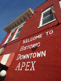 Welcome to Historic Downtown Apex, North Carolina. Town sign painted on a brick wall welcoming all to Historic Downtown Apex, North Carolina (NC stock photos