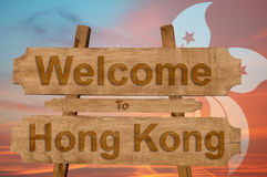 Welcome to Hong Kong sign on wood background with blending national flag Stock Photography