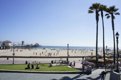 Welcome to Huntington Beach. The Huntington Beach is located in CA in between Seal Beach and Newport Beach where swimmers gathered every summertime from the Royalty Free Stock Photography