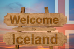 Welcome to Iceland sing on wood background with blending national flag Royalty Free Stock Image