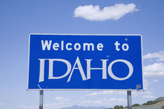 Welcome to Idaho Sign. Blue highway sign with Welcome to Idaho marking the state border Stock Photography