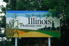 Welcome to Illinois sign. This is a road sign that says, the people of Illinois welcome you. There is a stalk of corn on one side of the sign, and the city Royalty Free Stock Photography