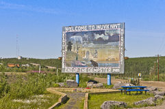 Welcome to Inuvik, NWT sign. The artistic welcome to Inuvik sign and the end of the Dempster Highway in the Canadian Northwest Territories Stock Image