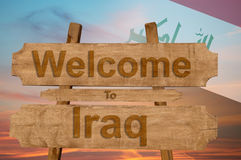Welcome to Iraq sing on wood background with blending national flag Royalty Free Stock Images