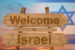 Welcome to Israel sing on wood background with blending national flag Royalty Free Stock Photos