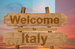 Welcome to Italy sing on wood background with blending national flag Royalty Free Stock Photography