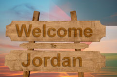 Welcome to Jordan sign on wood background with blending national flag Stock Photo