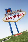 Welcome to Las Vegas sign with playing card suits in grass stock photography
