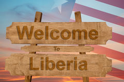 Welcome to Liberia sign on wood background with blending national flag Stock Photo