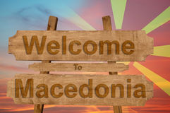 Welcome to Macedonia sign on wood background with blending nationa Royalty Free Stock Images