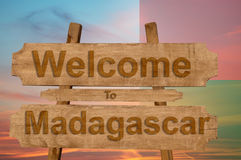 Welcome to Madagascar sign on wood background with blending nationa. L flag Stock Photos