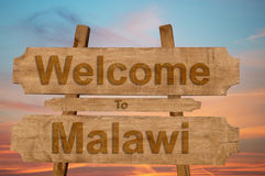 Welcome to Malawi sign on wood background Royalty Free Stock Photography