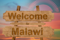 Welcome to Malawi sign on wood background with blending nationa Royalty Free Stock Photos