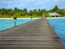 Welcome to Maldives. Dock with lights to an island in Maldives Royalty Free Stock Photo