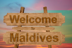 Welcome to Maldives sign on wood background with blending nationa Royalty Free Stock Image