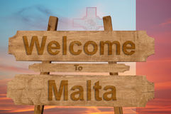 Welcome to Malta sign on wood background with blending nationa Stock Image