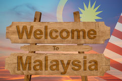 Welcome to Malysia sign on wood background with blending nationa. L flag Stock Photos