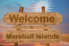 Welcome to Marshall Islands sign on wood background with blending national flag Stock Photos