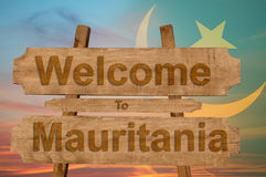 Welcome to Mauritania sign on wood background with blending national flag Stock Images