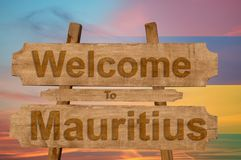 Welcome to Mauritus sign on wood background with blending national flag Royalty Free Stock Images