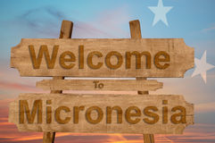 Welcome to Micronesia sign on wood background with blending nationa Royalty Free Stock Images