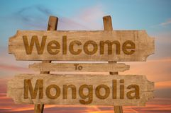 Welcome to Mongolia sign on wood background Royalty Free Stock Photography