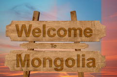 Welcome to Mongolia sign on wood background with blending nationa Royalty Free Stock Photography