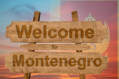 Welcome to Montenegro sign on wood background with blending national flag Stock Photo
