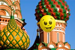 Welcome to Moscow. Yellow happy face balloon against The Saint Basil's Cathedral and blue sky Stock Image