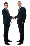 Welcome to my office. Happy business partners shaking hands stock photography