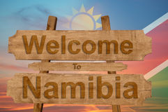 Welcome to Namibia sign on wood background with blending national flag Stock Photography