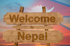 Welcome to Nepal sign on wood background with blending nationa. L flag Royalty Free Stock Photography