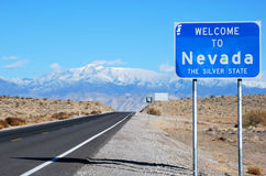 Welcome to Nevada sign. Against blue sky background Royalty Free Stock Photography