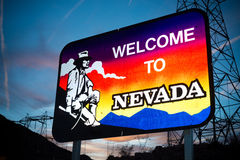 Welcome to Nevada state border sign. With a sky blue background stock photography