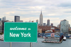 Welcome to New York sign. With famous skyline and boat docks along the Hudson River Royalty Free Stock Image