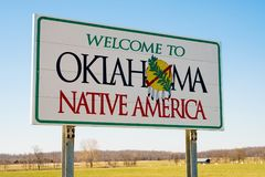 Welcome to Oklahoma Sign, Native America. Welcome ot Oklahoma Sign on a sunny blue sky day Royalty Free Stock Images
