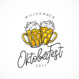 Welcome to Oktoberfest. Two mugs of beer. Welcome to Oktoberfest 2017. Vector illustration on white background. German folk festivities. Lettering and Royalty Free Stock Photos
